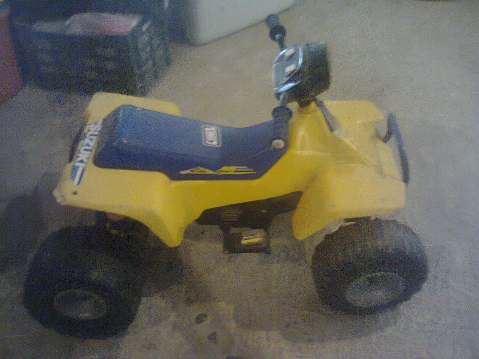 Toy Four Wheeler.... Needs new battary and cables.