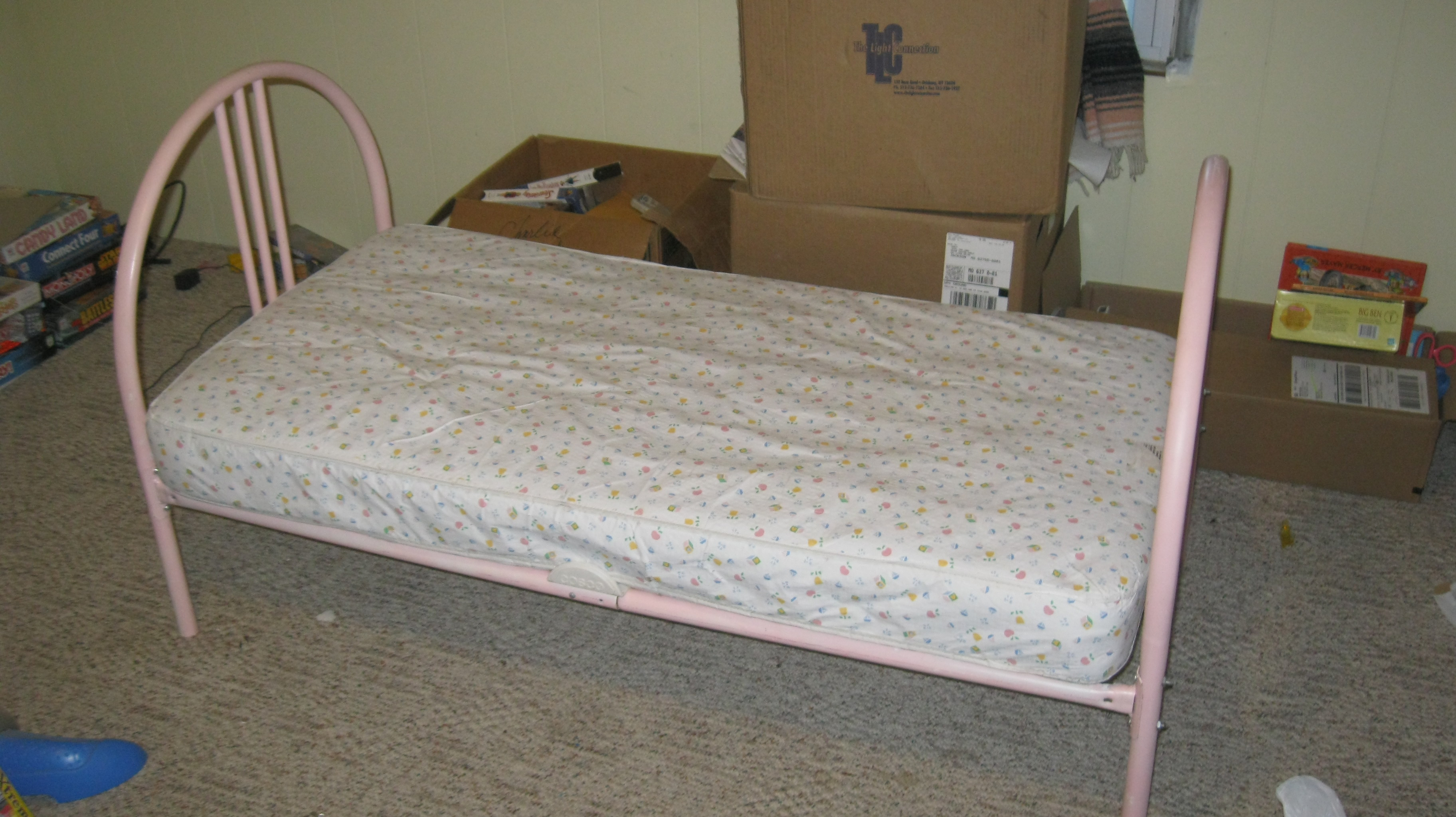 pink toddler bed with mattress