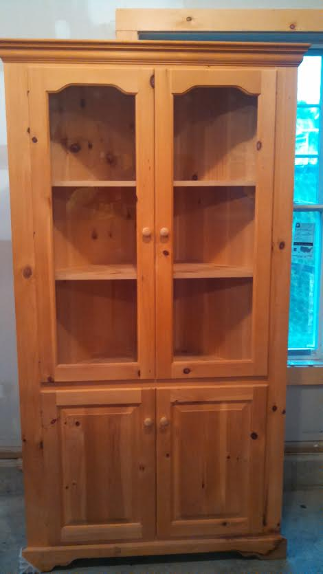 unfinished pine corner cabinet with glass doors in