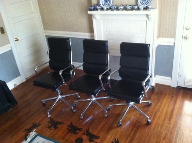 Three adjustable office chairs