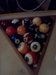 Pool table balls in box