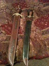 2 swords with leather scabbards