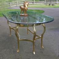 Glass table with horsehead brass base