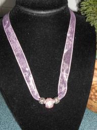 Pink crystal studded ribbon necklace