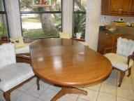 Oval kitchen table with 3 large chairs on casters