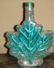 Beautiful handcrafted decor leaf bottle