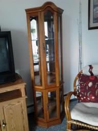 2-corner curio cabinets selling as a pair