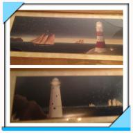 2 framed lighthouse pictures