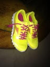 Yellow and pink Reebok Zigs