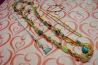 3 necklaces, 1 bracelet, 1 pair earrings group