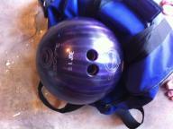 Purple bowling ball with bag