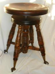 Antique adjustable piano stool w/glass ball eagle claws