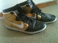 Pair of gold and black nikes