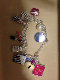 Avon sales rep charm bracelet