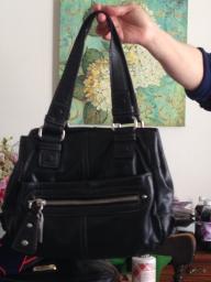Mid sized black purse