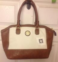 Anne Klein bucket purse, brown And white in c