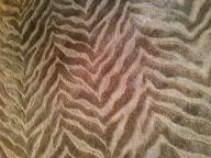 8' chocolate brown round rug with animal stripe textured design