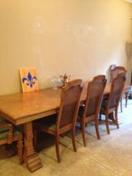 solid wood 6 chair dining room table with matching china cabinet