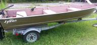 14 ft Sylvan boat w\ trailer.