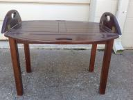 Oval coffee table with folding sides