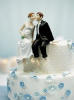 whimsical wedding cake topper bride and groom sitting