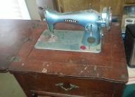 Precision deluxe antique sewing machine  (model 202 ) with wood c