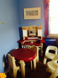 Play kitchen, table, and chairs