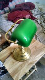 Brass desk lamp with emerald glass.
