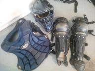 Softball catcher's equipment package with two chest protectors