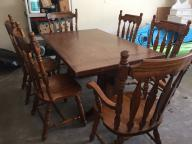 Seven-piece heavy wood dining set.